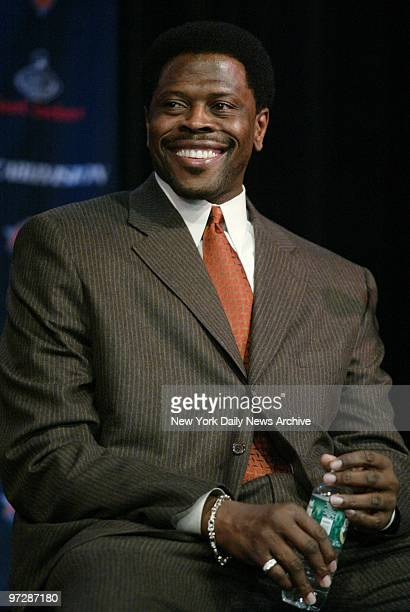 Former New York Knick Patrick Ewing grins during a news conference at the Theater in Madison Square Garden before start of game between the Knicks...
