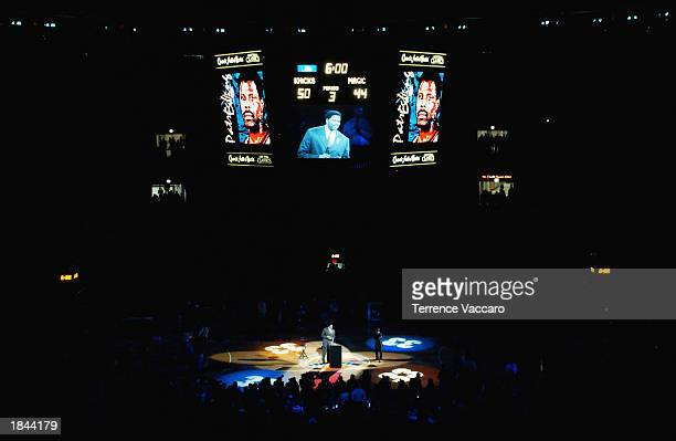 Former New York Knick Patrick Ewing speaks during a halftime celebration for his number retirement in the game between the Orlando Magic and the...