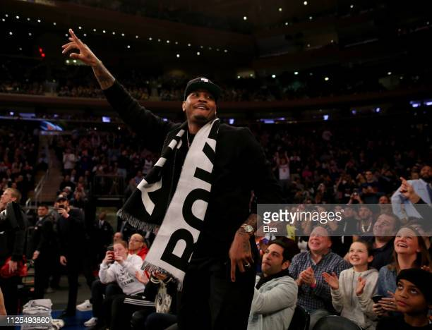 Former New York Knicks player Carmelo Anthony waves to the fans in the first quarter against the Miami Heat at Madison Square Garden on January 27,...