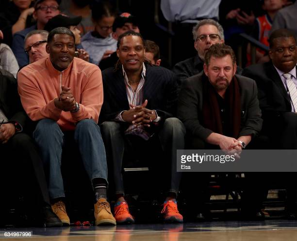 Former New York Knicks playes Larry Johnson and Latrell Spreewell and Knicks owner James Dolan attend the game between the New York Knicks and the...