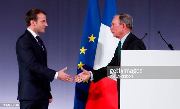 Former New York mayor and United Nations special envoy for cities and climate change Michael Bloomberg shakes hands with French president Emmanuel...