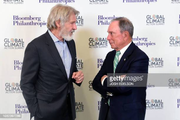 Former New York Mayor Michael R Bloomberg speaks with US actor Harrison Ford during the opening reception for the Global Climate Action Summit in San...