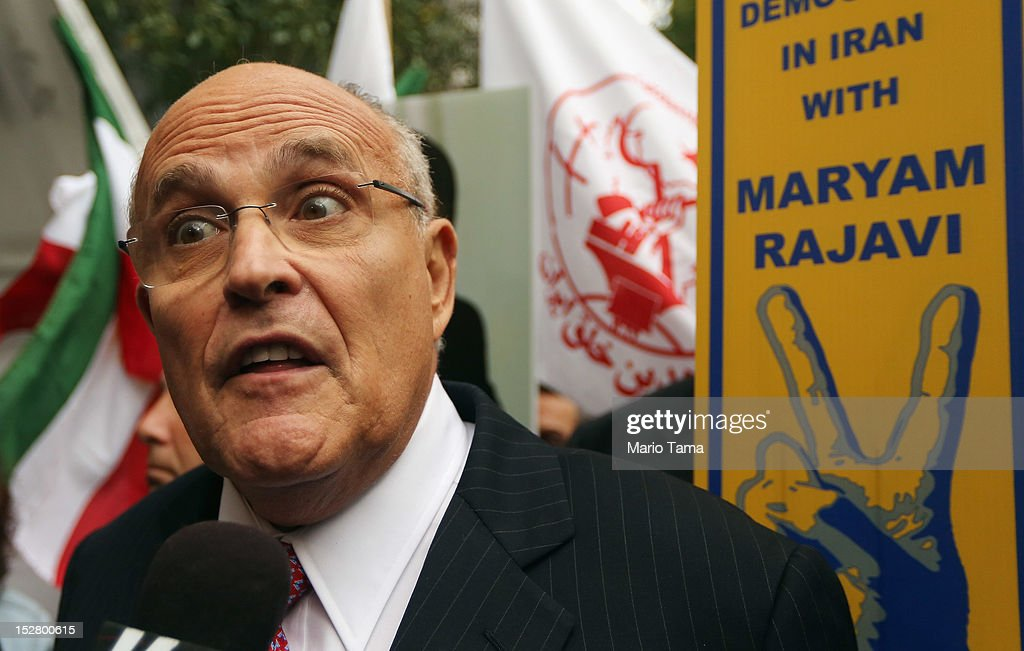 Former New York Mayor Rudolph Giuliani speaks to the media at a rally of groups opposing Iranian President Ahmadinejad's speech at the United Nations General Assembly on September 26, 2012 in New York City. Politicians including Giuliani, former House Speaker Newt Gingrich, former Homeland Security Secretary Tom Ridge, former New Mexico Governor Bill Richardson and former U.N Ambassador John Bolton spoke at the pro-democracy rally which also included Syrian pro-democracy protesters.