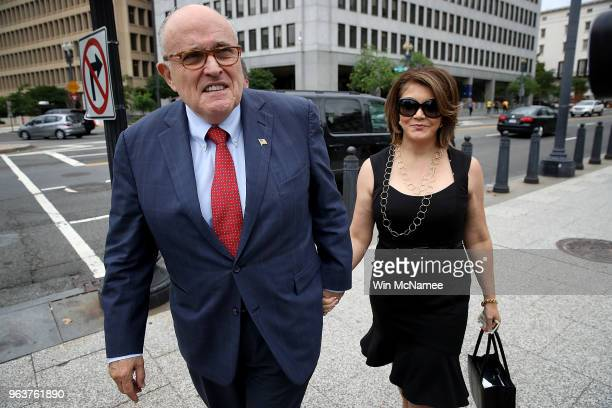 Former New York mayor Rudy Giuliani arrives at the White House with Jennifer LeBlanc on May 30 2018 in Washington DC Giuliani one of US President...