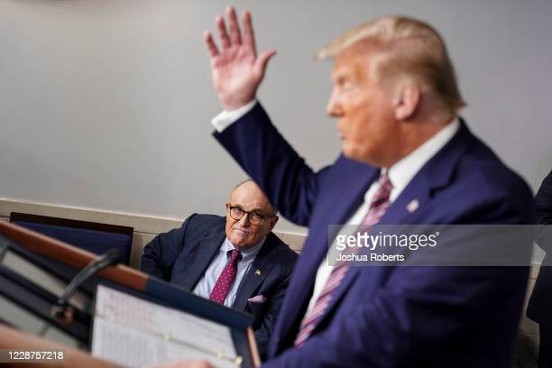 Former New York Mayor Rudy Giuliani listens as US President Donald Trump speaks during a news conference in the Briefing Room of the White House on...