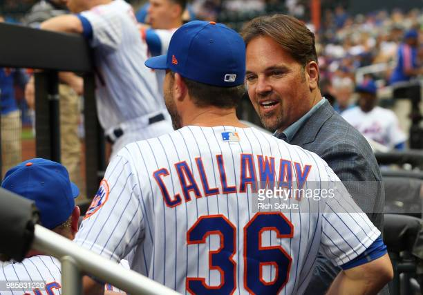 Former New York Mets catcher and Hall of Famer Mike Piazza talks with manager Mickey Callaway before he threw out the first pitch before a game...