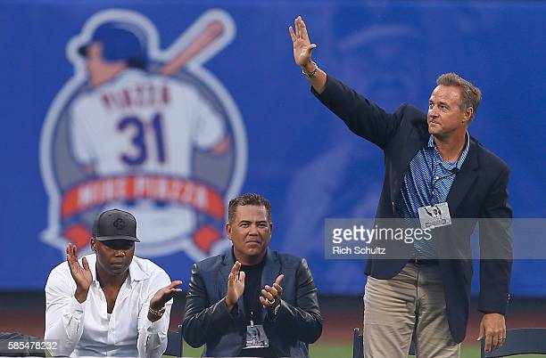 Former New York Mets' Cliff Floyd Edgardo Alfonzo and Al Leiter are acknowledged during Mike Piazza's number retirement ceremony before the start of...