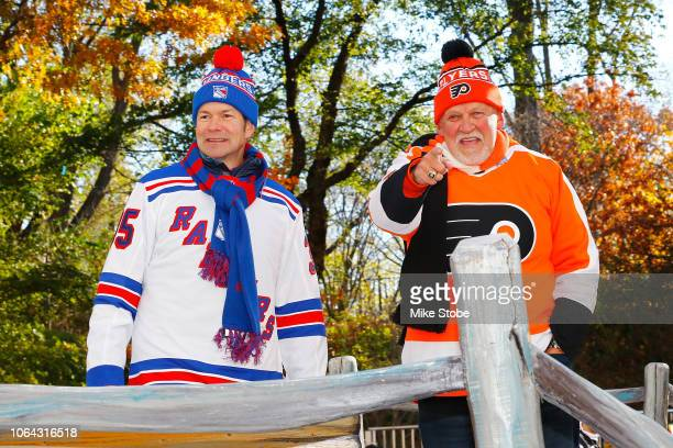 Former New York Ranger Mike Richter and Former Philadelphia Flyer Bernie Parent waves at fans as they ride the 2018 Discover NHL Thanksgiving...