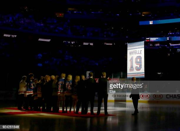 Former New York Rangers Jean Ratelle and his familey watches as the banner with his name and number are lifted into the rafters before the game...