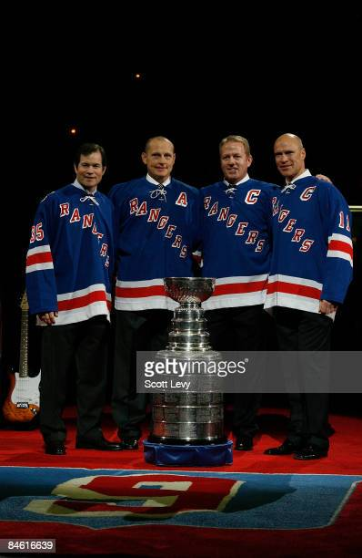 Former New York Rangers Mike Richter Adam Graves Brian Leetch and Mark Messier pose after Graves' jersey was raised to the rafters of Madison Square...