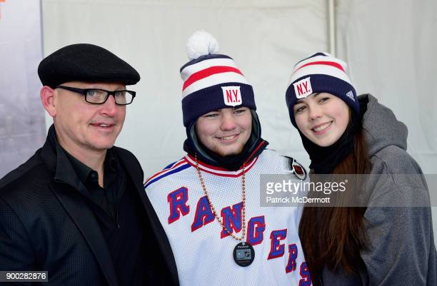 Former New York Rangers player Adam Graves poses with fans prior to the 2018 Bridgestone NHL Winter Classic between the New York Rangers and the...