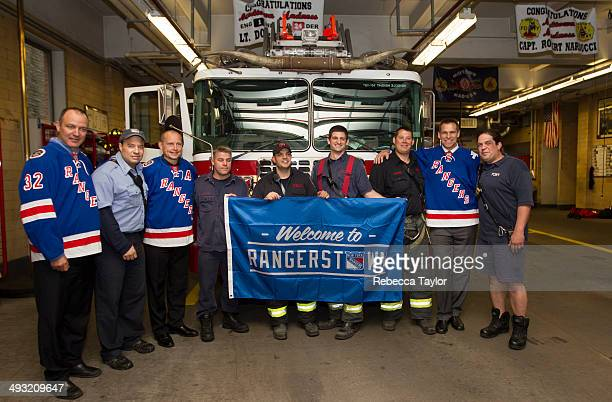 Former New York Rangers Stephane Matteau Adam Graves and Jeff Beukeboom present members of Engine 1 / Ladder 24 of the FDNY with a Rangerstown banner...