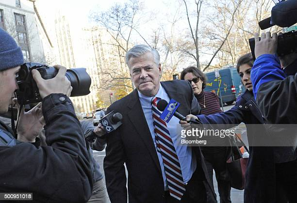 Former New York Senate Majority Leader Dean Skelos center arrives at federal court with his wife Gail Skelos right in New York US on Friday Dec 11...