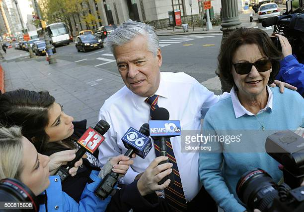 Former New York Senate Majority Leader Dean Skelos center talks to reporters while arriving with his wife Gail Skelos at federal court in New York US...