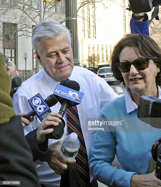 Former New York Senate Majority Leader Dean Skelos left talks to reporters while arriving with his wife Gail Skelos at federal court in New York US...