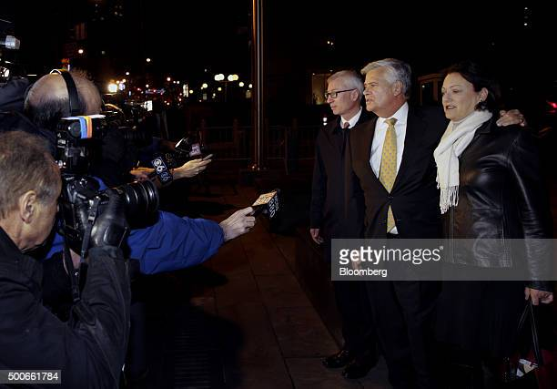 Former New York Senate Majority Leader Dean Skelos second right exits federal court with wife Gail Skelos right in New York US on Wednesday Dec 9...