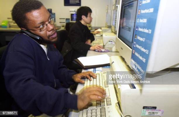 Former New York Times reporter Jayson Blair whose fraudulent reporting kicked off a journalistic storm checks his Email while speaking on the mobile...