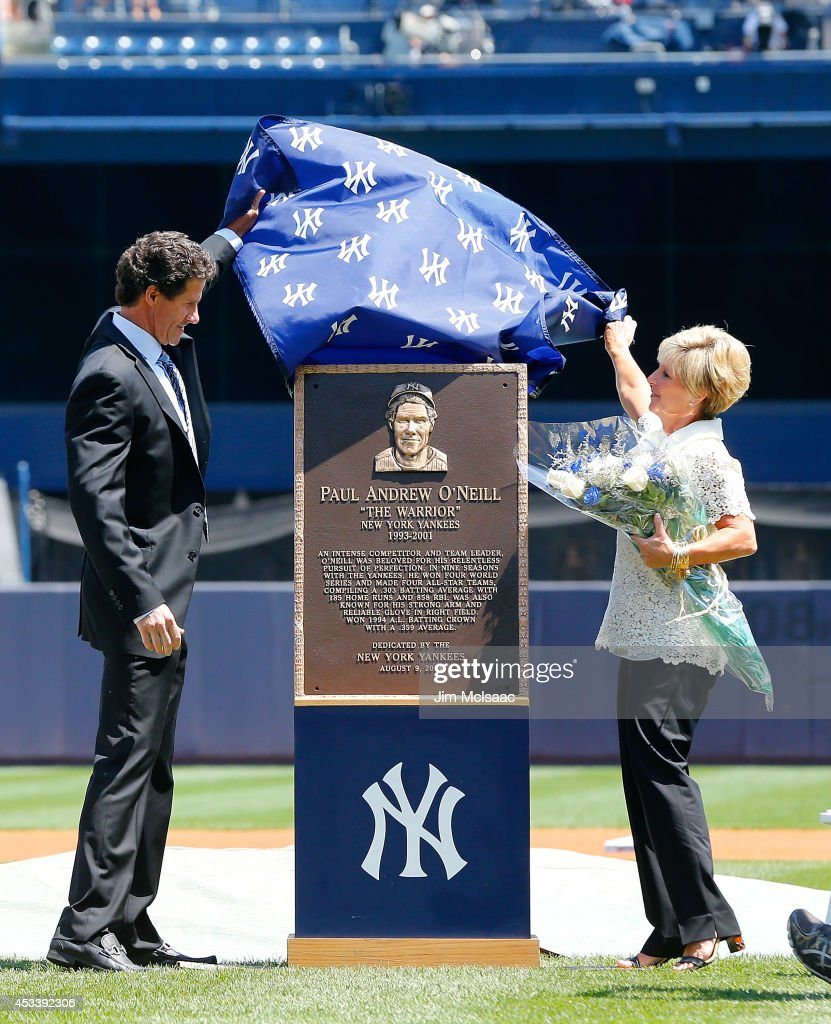 Former New York Yankee Paul O'Neill and his wife Nevalee unveil his Yankee Stadium monument park plaque before a game against the Cleveland Indians on August 9, 2014 in the Bronx borough of New York City.