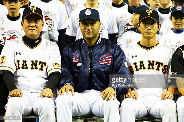 Former New York Yankee players Derek Jeter and Tatuniri Hara of Giants corch and Seiji Kobayashi of Giants player pose for photographers during the...