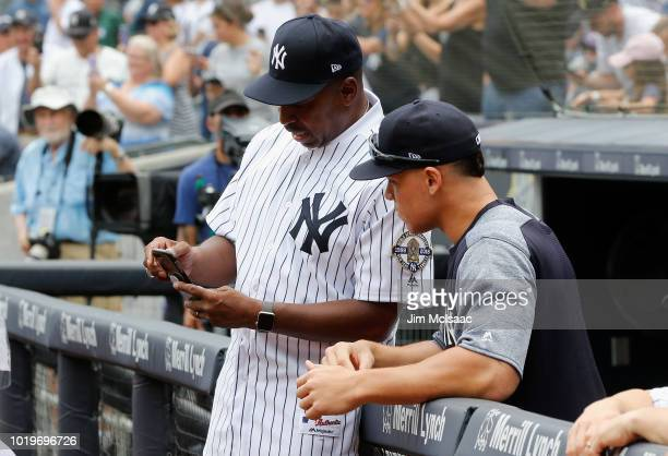 Former New York Yankee Willie Randolph talks with Aaron Judge prior to a game against the Toronto Blue Jays at Yankee Stadium on August 18 2018 in...