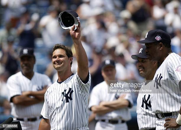 Former New York Yankees' first baseman Don Mattingly acknowledges the crowd's applause during his introduction as former Yankee legends Reggie...