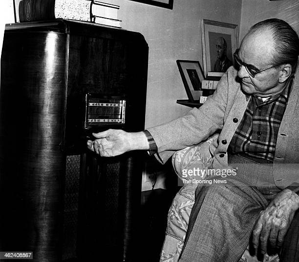 Former New York Yankees front office executive Edward Barrow listens to the radio.