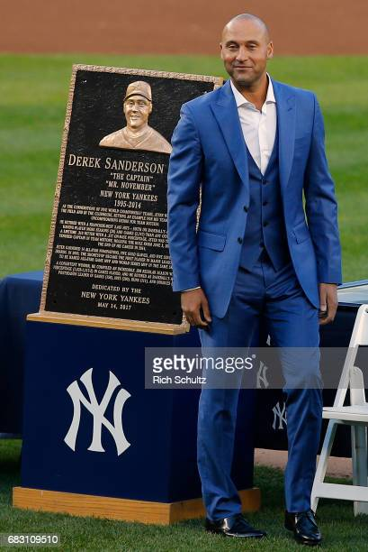 Former New York Yankees great Derek Jeter stands by his plaque during a pregame ceremony honoring Jeter and retiring his number 2 at Yankee Stadium...