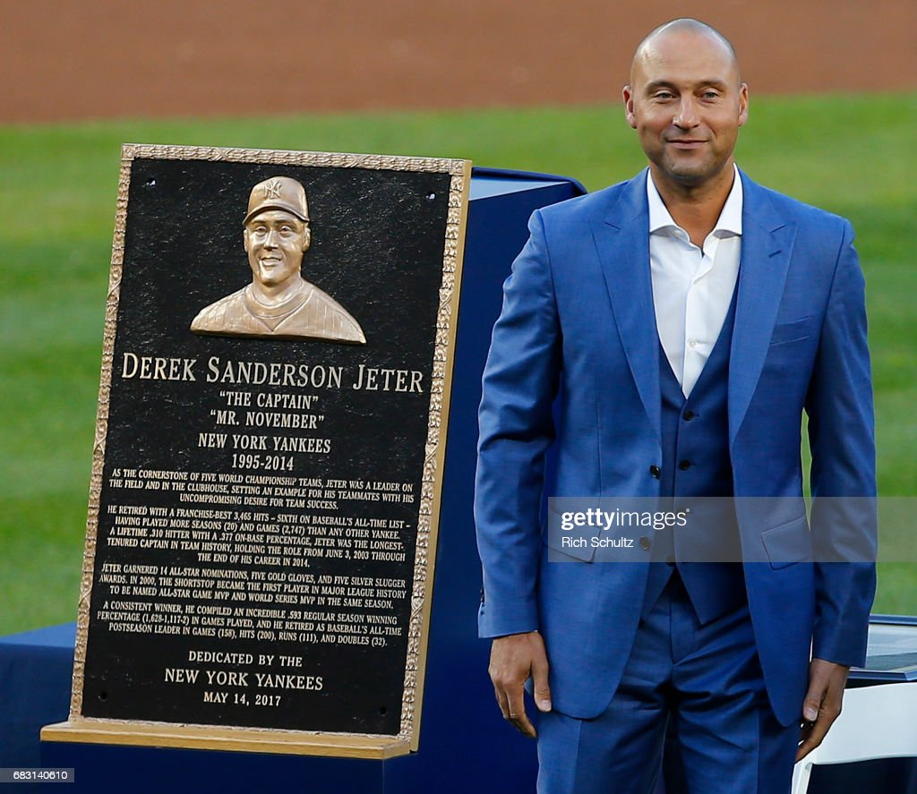 Former New York Yankees great, Derek Jeter stands by his plaque during a pregame ceremony honoring Jeter and retiring his number 2 at Yankee Stadium on May 14, 2017 in New York City.