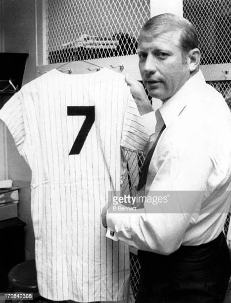Former New York Yankees great Mickey Mantle holds up his jersey in the locker room during the 1969 season at Yankee Stadium in Bronx New York Mantle...