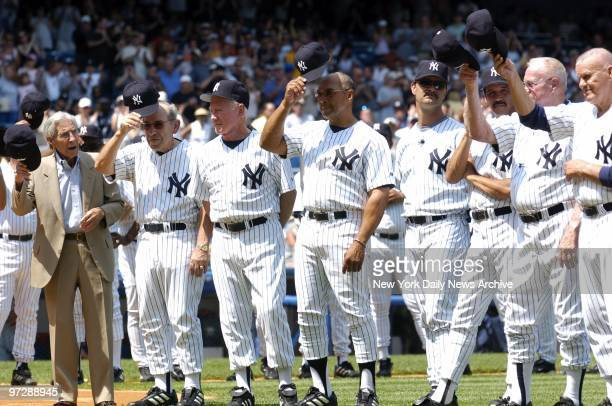 Former New York Yankees' legends Phil Rizzuto Yogi Berra Whitey Ford Reggie Jackson Don Mattingly and other Yankee greats tip their caps to the crowd...