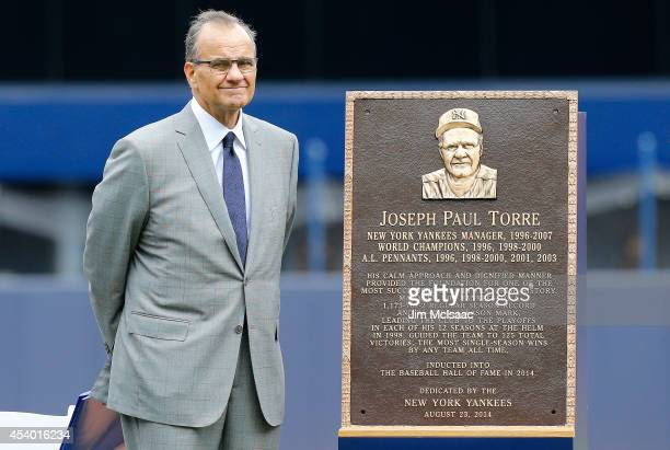Former New York Yankees manager Joe Torre stands with his plaque that will be installed in Monument Park at Yankee Stadium during a ceremony prior to...