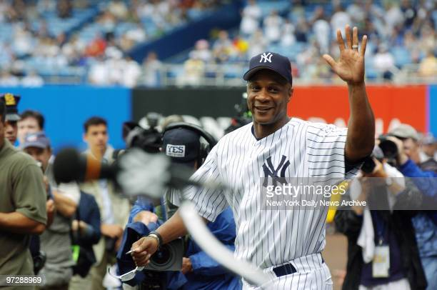 Former New York Yankees' outfielder Darryl Strawberry waves as he's introduced during 60th annual OldTimer's Day ceremonies at Yankee Stadium He was...