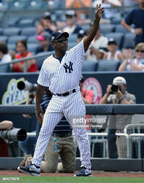 Former New York Yankees outfielder Rickey Henderson acknowledges the crowd after being introduced for the 71st Annual Old Timers Day at Yankee...