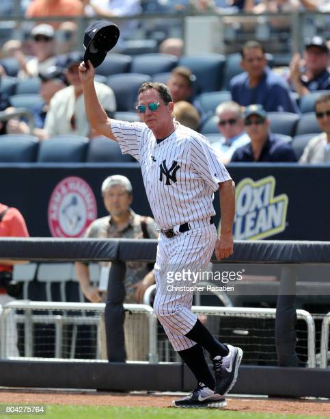 Former New York Yankees pitcher David Cone acknowledges the crowd after being introduced for the 71st Annual Old Timers Day at Yankee Stadium on June...