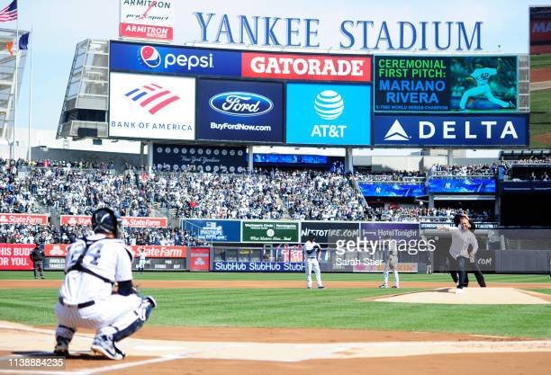 Former New York Yankees pitcher Mariano Rivera throws out the ceremonial first pitch to Gary Sanchez of the New York Yankees before the game against...