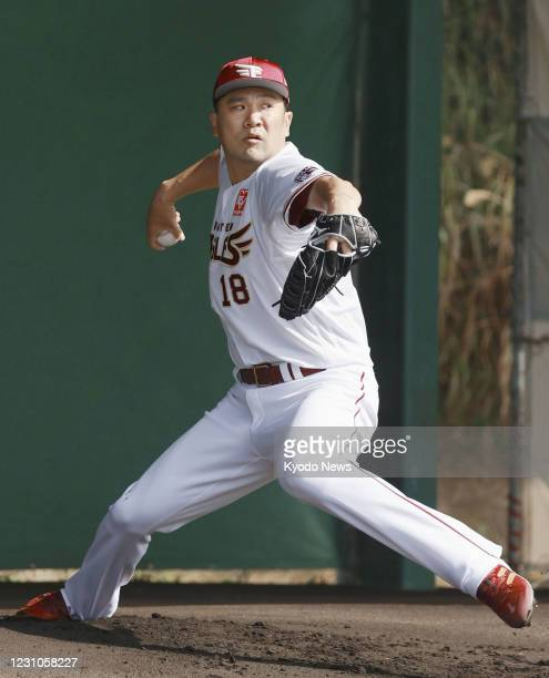 Former New York Yankees pitcher Masahiro Tanaka throws a bullpen session during the Rakuten Eagles' spring training in the Okinawa Prefecture town of...