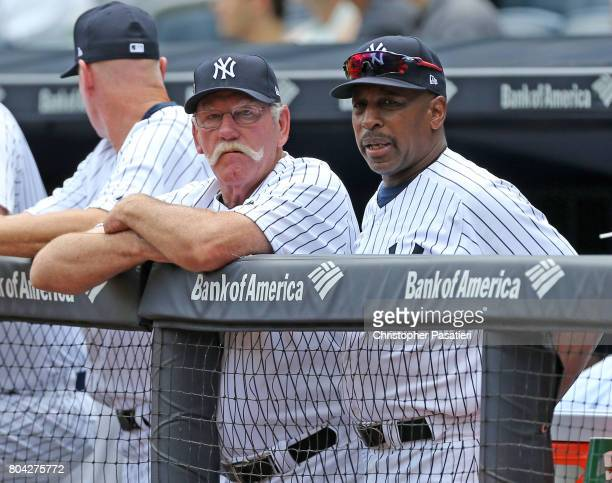 Former New York Yankees pitcher Sparky Lyle and infielder Willie Randolph look on from the dugout out as they wait to be introduced for the 71st...