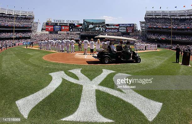 Former New York Yankees stand for the national anthem during the Yankees 66th Annual Old Timers day prior to the game against the Chicago White Sox...