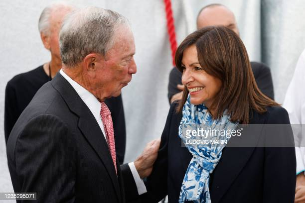 Former New York's mayor Michael Bloomberg speaks with Paris Mayor and Socialist Party candidate for the 2022 French presidential elections Anne...
