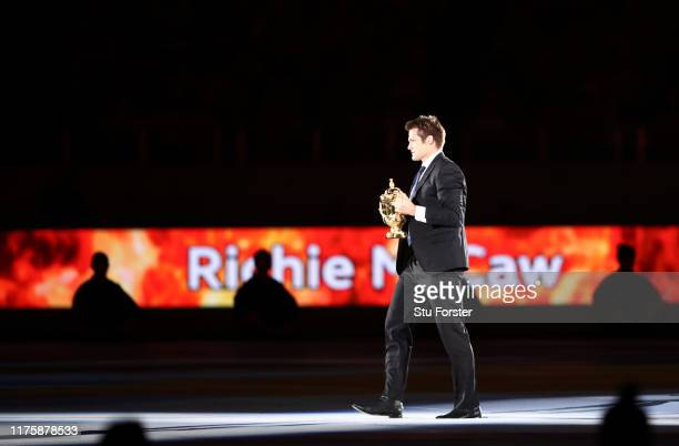 Former New Zealand captain Richie McCaw holds the Webb Ellis Cup during the opening ceremony prior to the Rugby World Cup 2019 Group A game between...