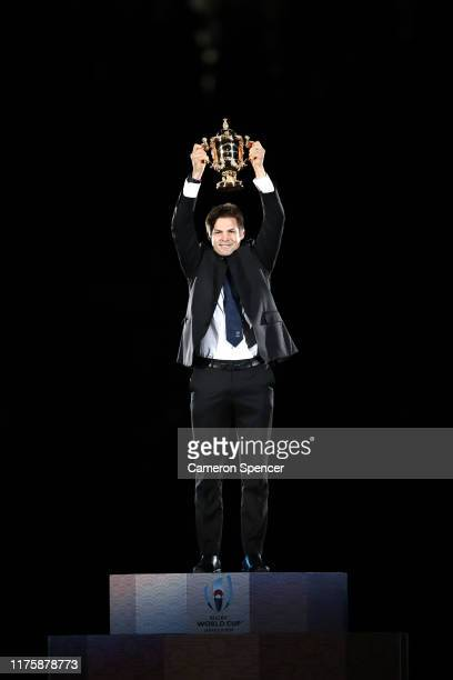 Former New Zealand captain Richie McCaw lifts the Webb Ellis Cup during the opening ceremony prior to the Rugby World Cup 2019 Group A game between...