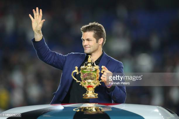 Former New Zealand captain Richie McCaw transports the Web Ellis Cup to the trophy ceremony following the Rugby World Cup 2019 Final between England...