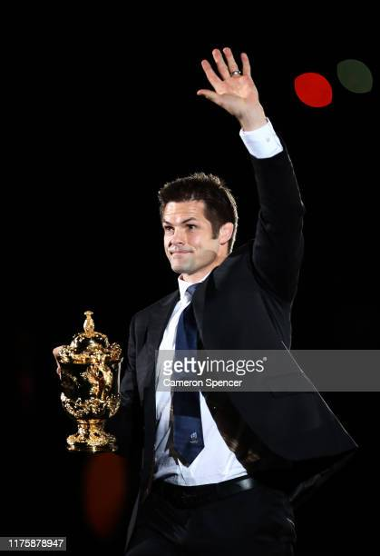 Former New Zealand captain Richie McCaw waves to crowd while holding the Webb Ellis Cup during the opening ceremony prior to the Rugby World Cup 2019...