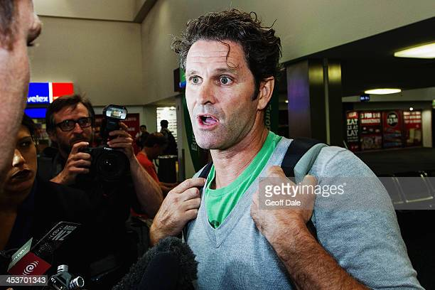 Former New Zealand cricketer Chris Cairns arrives at Auckland Airport on December 5 2013 in Auckland New Zealand Cairns was today named as one of...
