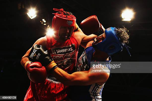 Former New Zealand cricketers Simon Doull and Chris Cairns fight during 'Fight for Life' at The Trusts Stadium on December 14 2013 in Auckland New...