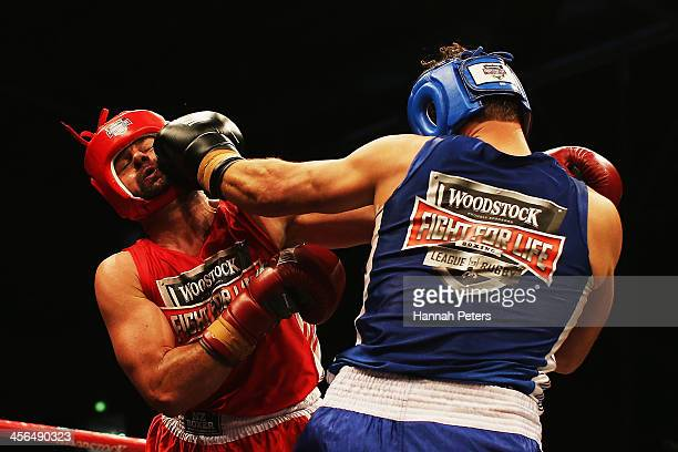 Former New Zealand cricketers Simon Doull and Chris Cairns fight during 'Fight for Life' at The Trusts Stadium on December 14, 2013 in Auckland, New...