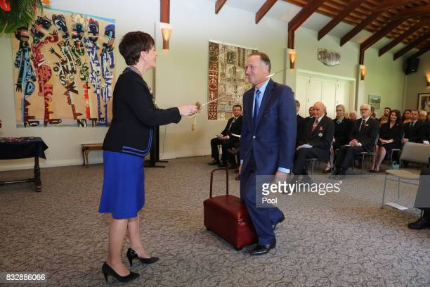 Former New Zealand Prime Minister Sir John Key is knighted by New Zealand GovernorGeneral Dame Patsy Reddy at Government House on August 16 2017 in...