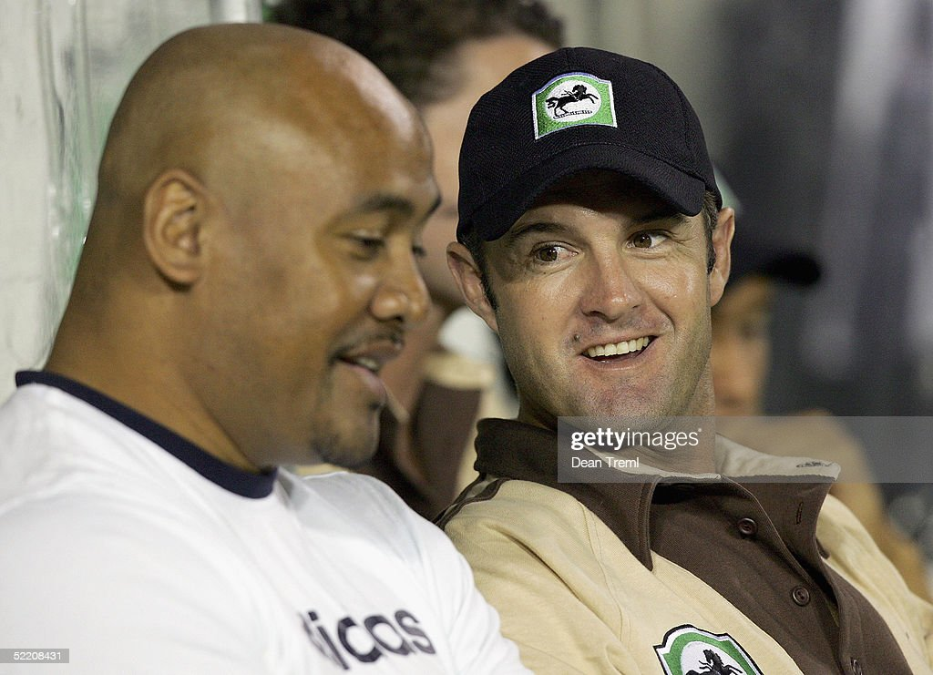 Former New Zealand rugby player Jonah Lomu (L) sits next to New Zealand cricketer Nathan Astle during the International Twenty20 game played between the New Zealand Black Caps and Australia at Eden Park on February 17, 2005 in Auckland, New Zealand.