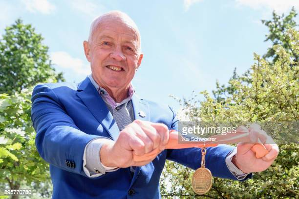 Former New Zealand runner Dick Tayler poses with his 1974 Christchurch Commonwealth Games gold medal during a Commonwealth Games Queens Baton Relay...