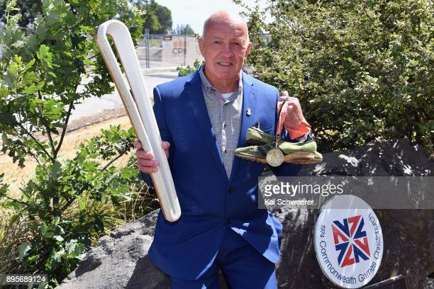 Former New Zealand runner Dick Tayler poses with the Commonwealth Games Queen's baton his running shoes and the 1974 Christchurch Commonwealth Games...